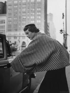 Model Wearing Checkered, Deep Cuffed Fleece Coat Designed by Pauline Trigere by Nina Leen