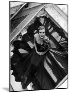 Model Wearing Rose Decked Gorgeous Gown by Traina Norell by Nina Leen