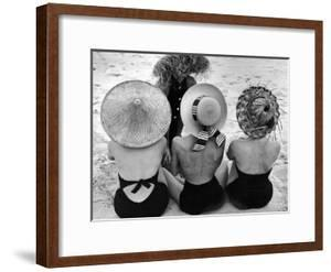 Models on Beach Wearing Different Designs of Straw Hats by Nina Leen