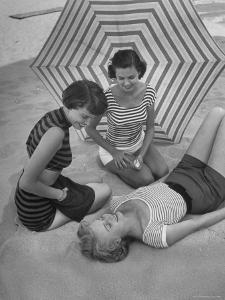 Models on Beach Wearing Latest Beach Fashions by Nina Leen