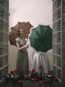 Models Posing with Umbrellas in a Macy's Department Store Display, New York, NY, 1948 by Nina Leen