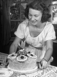 Nancy Drooling over a Pineapple Cake by Nina Leen