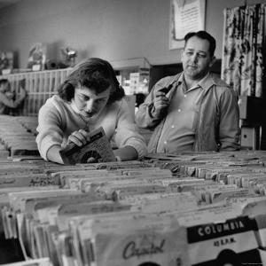 Pay in Trade Taken by High School Music Store Worker Margaret High, Spending Salary on Records by Nina Leen