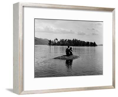 Private Island, Young Couple Embracing on a Small Rock Protruding from the Waters of Lake George