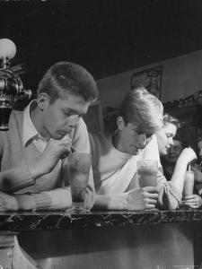 Teen Age Boys and Girls Drinking Milkshakes in Drug Store by Nina Leen