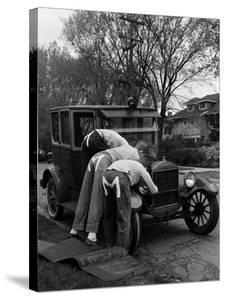 Teenaged Boys Working on a 1927 Ford Model T Automobile by Nina Leen