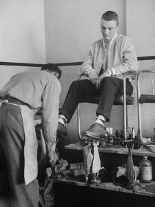 Teenager Getting Shoes Shined by Nina Leen