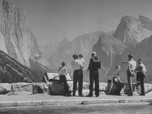 Tourists Looking at the Mountains in Yosemite Valley Park by Nina Leen