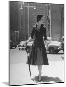 Town Suit, Triangular Button Closings, Can Be Worn All Year Round by Nina Leen