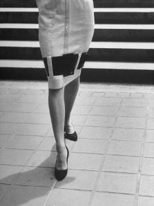 Waist-Down View of Dress with Belt as an Accent around Knees by Nina Leen