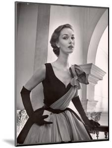 Woman Modeling a Short Ball Gown by Nina Leen