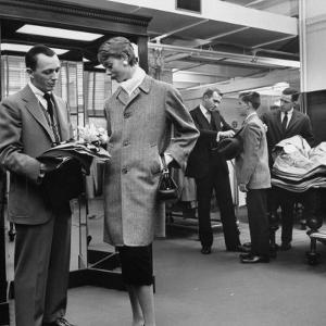 Woman Shopping in Brooks Brothers Wearing Men's Tweed Topcoat by Nina Leen