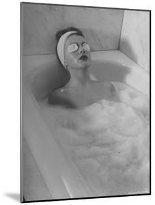 Woman Showing How to Take a Bath by Nina Leen
