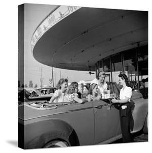 Women and Girls, in Convertible at Drive In, Greet Female Car Hop, Who Just Brought Their Drinks by Nina Leen