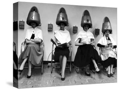 """Women Sitting and Reading under Hairdryers at Rockefeller Center """"Pamper Club"""""""