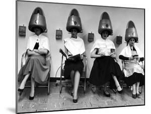 """Women Sitting and Reading under Hairdryers at Rockefeller Center """"Pamper Club"""" by Nina Leen"""