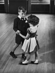 Young Boy and Girl Taking Dancing Lessons by Nina Leen
