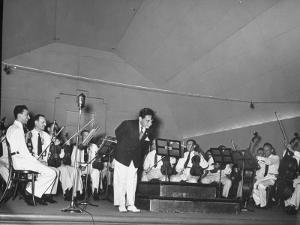 Young Conductor Lorin Maazel Taking a Bow at a Concert by the Robin Hood Dell Orchestra by Nina Leen