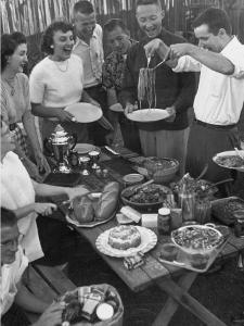 Young Married Couples Enjoying a Backyard Buffet Feast , Featuring Spaghetti by Nina Leen