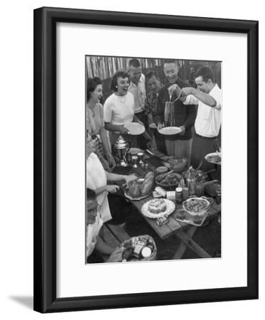 Young Married Couples Enjoying a Backyard Buffet Feast , Featuring Spaghetti