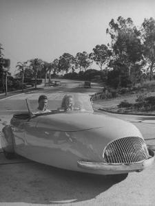 Young People Driving a Three Wheeled Auto by Nina Leen