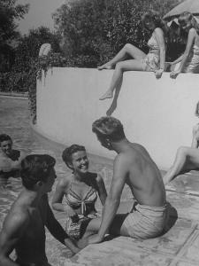 Young People Enjoying the Swimming Pool at Home of Herbert Stothart by Nina Leen
