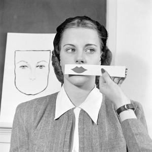 Young Woman at Stephens College Sampling Different Shades of Lipstick, Columbia, Missouri, 1945 by Nina Leen