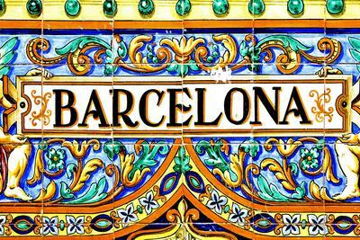 A Barcelona Sign Over A Mosaic Wall