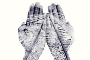 Double Exposure of the Palms of a Man Put Together and a Railway, in Black and White by nito