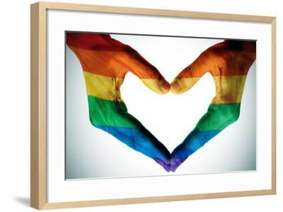 Man Hands Painted As The Rainbow Flag Forming A Heart, Symbolizing Gay Love