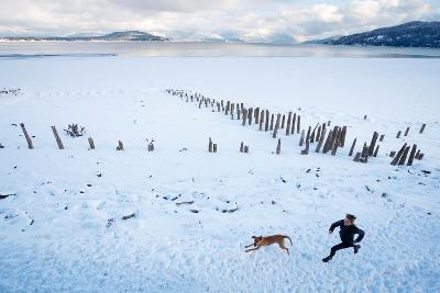 Noelle Zmuda And Her Dog Tink Go For A Cold Winter Run On Pond Oreille Bay Trail, Sandpoint, Idaho-Ben Herndon-Photographic Print