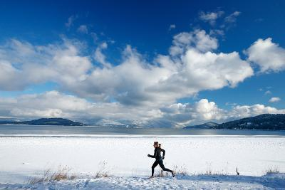 Noelle Zmuda Goes For Winter Run On The Pond Oreille Bay Trail, Sandpoint, Idaho. Lake Pend Oreille-Ben Herndon-Photographic Print