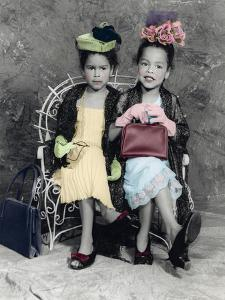 2 Girls Sitting on a Bench, with Hats and a Purse by Nora Hernandez
