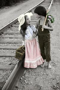 Boy and Girl Carrying Packs Walking by Railroad Tracks by Nora Hernandez