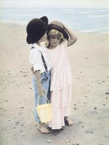 Boy and Girl on Beach by Nora Hernandez
