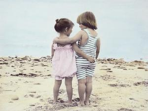 Boy and Girl with their Arms around Each Other on the Beach by Nora Hernandez