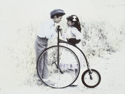 Little Boy and Girl by Old Fashioned Bicycle