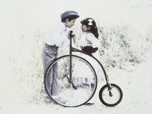 Little Boy and Girl by Old Fashioned Bicycle by Nora Hernandez