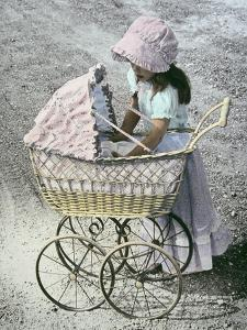 Little Girl Checking on Baby in Carriage by Nora Hernandez