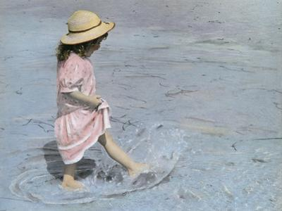 Little Girl Playing in Water on Beach by Nora Hernandez
