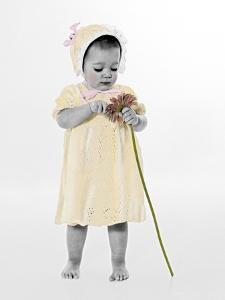 Little Girl Standing Holding a Sunflower by Nora Hernandez
