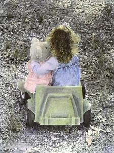Little Girl with Her Teddy Bear Riding in a Toy Car by Nora Hernandez
