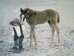 Little Kid Dressed Like Cowboy with Horse by Nora Hernandez