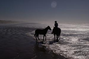 Man with Horses on the Beach by Nora Hernandez