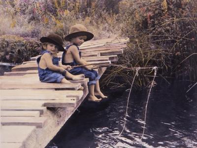 Two Boys Fishing Off of Bridge