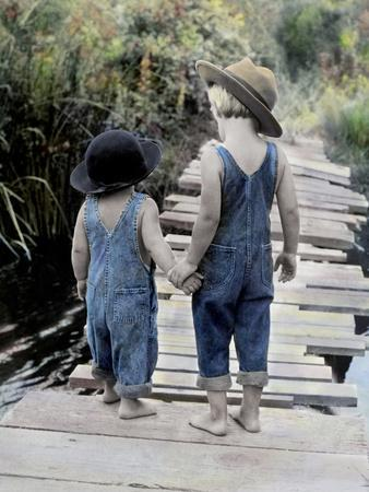 Two Boys Walking on Bridge Hand-In-Hand