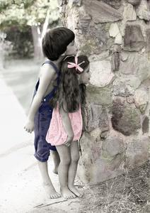 Young Boy and Girl Peeking around a Stone Wall. by Nora Hernandez