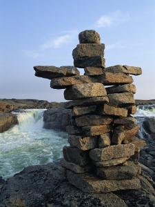 A Carefully Balanced Cairn Overlooking the Kerchoffer River by Norbert Rosing