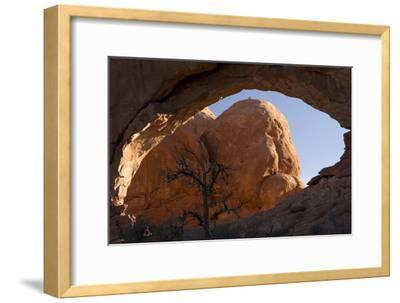 A View Through a Window-Like Arch at Nearby Rock Formations