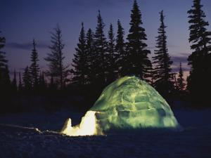 A Warm Glow Eminates from an Igloo by Norbert Rosing